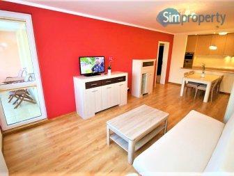 2-bedroom apartment with balcony close to Grunwaldzki Square.
